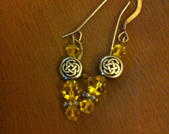 Citrine and silver pierced earrings with Celtic knot beads.