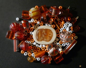 Orange, white with various shapes Indian glass beads