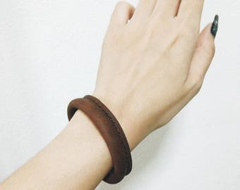Leather wrapped bangle.