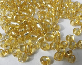 200 seed beads 4 mm clear seed beads and gold leaf gold