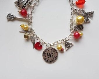 Harry Potter charm bracelet Gryffindor colours.