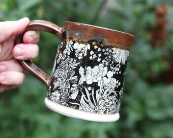 Stoneware Mug with Black Floral Print and Rust Orange Glaze