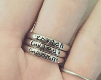 Hand stamped stainless steel stacking name rings or birthstone anniversary bands