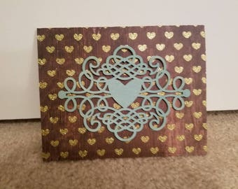 Gold and teal heart
