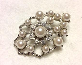 Imitation pearls and clear rhinestone wedding bouquet brooch pin.