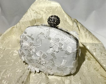 Framed white 3D lace overlay box clutch with Rhinestone hasp