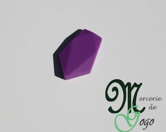 Flat purple arrow shaped silicone bead.