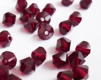 50 Siam 4 mm swarovski crystal bicone beads