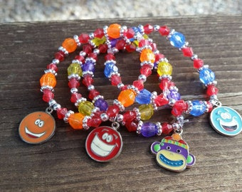 4 Hand Beaded Stacking Stretch Bracelets with smile face and sock monkey charms - Handmade by Me - Orange, Red, Blue, Purple