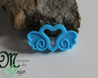"Teething ring. ""Carriage heart"" shape blue."