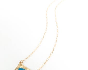 The Shielded One - gold and blue chalcedony shield pendant necklace.