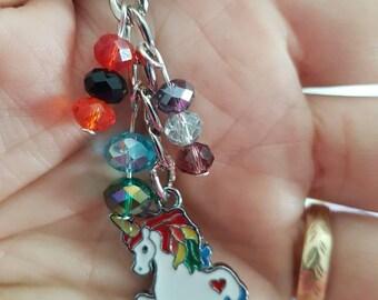 Unicorn bag charm or key ring/ key chain made by the jewellery geek.