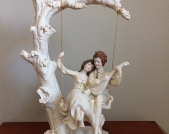 Vintage A.Belcari/Capodimonte  signed - Made In Italy -  Couple w/Guitar on a Tree Swing