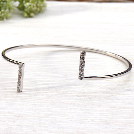Bangle is solid and cubic zirconia silver bars