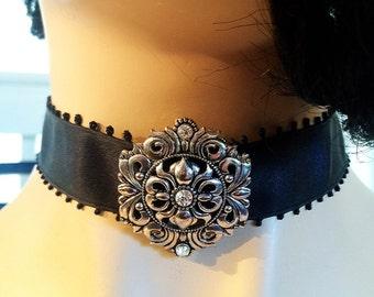 Black ribbon choker with flower pendant (white rhinestones)