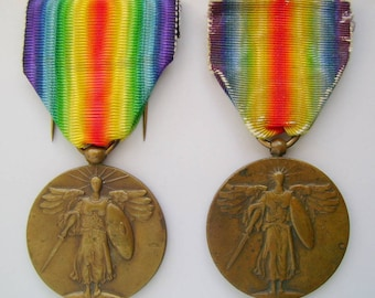 Two (2) US WWI Victory Medals - French-made, rim hallmarked