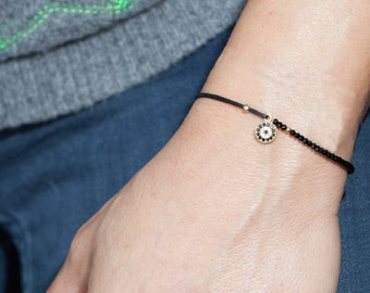 target charm bracelet with sparkly spinel. evil eye bracelet. gemstone bracelet  and waxed cord. delicate bracelet