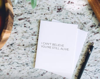 I Can't Believe You're Still Alive - Inappropriate, Offensive, Sarcastic and Funny Letterpress Greeting Card
