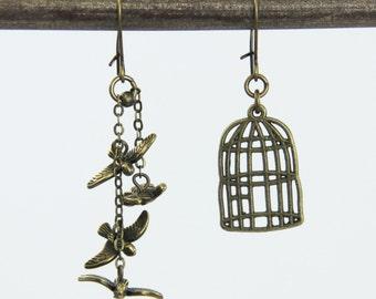 Out with Friends - Charming Bird Birdcage Antique Brass Bronze Asymmetrical Earrings Neutral Fun Woodland Flying Birds Dangle