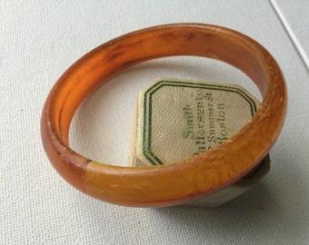 Mottled Orange lucite bangle half round.  VJSE