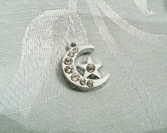 Silver Star and rhinestone Moon pendant