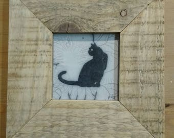Picture in raku pottery black cat