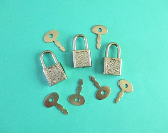 Three Vintage Little Locks with Six Keys