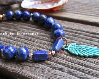 Lapis Lazuli Gemstone Bracelet with Angel Wing Patina Charm and Rose Gold Vermeil Accent Spacers.