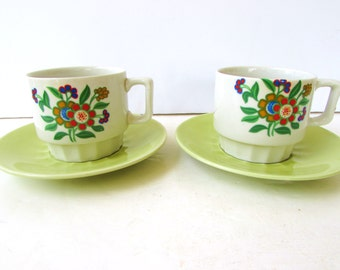 Set of 2 Vintage Coffee Mugs with Saucers - Floral Mugs - Groovy 60's 70's floral  Bright Oranges, and Apple Green on White. Made in Japan.