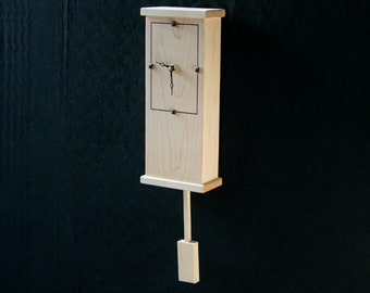 Hanging clock, a modern minimalist clock which will hang well in the living room or office.