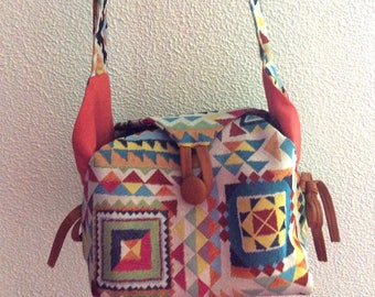Ethnic pattern and leather shoulder bag