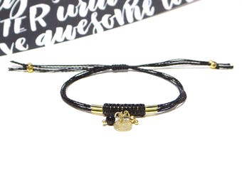 Golden charms and black macrame adjustable bracelet