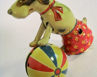 Vintage wind up tin litho toy. Dog with ball. Beagle in skirt. No key, does not work. Made in Germany US Zone