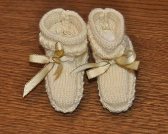 cream color and Ribbon baby booties