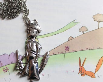 A necklace pendant engraved little Prince and Fox tamed silver-plated