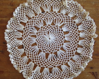 "Vintage Hand-crocheted 16"" round ivory-colored doily"
