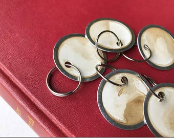 Altered Vintage Stained Key Tags . Set of Eight . Metal Rimmed with O-Rings . Journal Embellishments . Round Tags . Price Tags/Gift Tags .