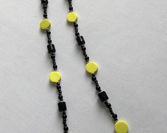 Bright yellow and black beaded necklace