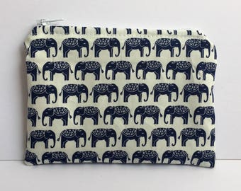 Handmade coin purse/zipper pouch/purse made with elephant print cotton and fully lined with a tan cotton fabric