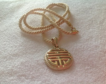 Pendant necklace SARAH COVENTRY Chinese symbol