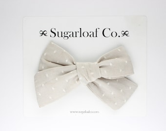 Lolli Bow | Cream Swiss Dot | Hand Tied Bow on a Stretchy Nylon Headband or Alligator Clip