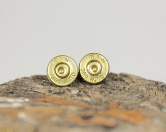 Winchester 380 Auto Bullet Slice Earrings: Brass Bullet Slices with Primers on Surgical Steel Posts and Clutches.