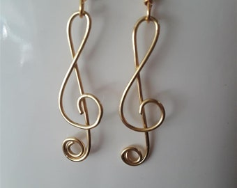 Set of Gold and Silver Treble Clef Earrings