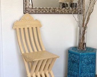 Hand-carved with mother of pearl inlay folding chair