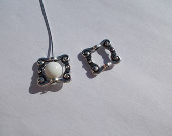 1 spacer or 2 Pearl connectors set in silver