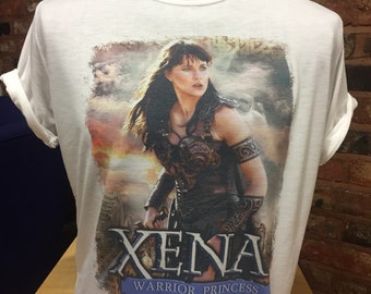 Xena Warrior Princess - White T-Shirt. Men's and Women's Sizes. Lucy Lawless