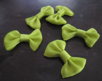 2 yellow 37x25mm bows made of cotton and polyester