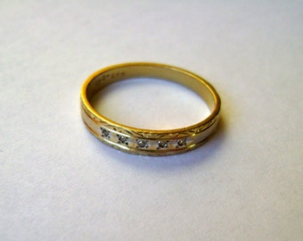 5 tiny diamonds in a 10k gold band, size 7