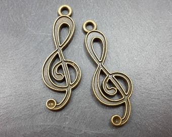 Music note pendant, charm note music - treble clef bronze metal - 32.5 x 11.5 mm