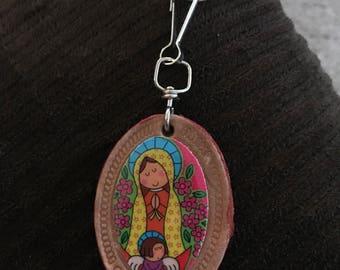 Virgencita keychain with an angel